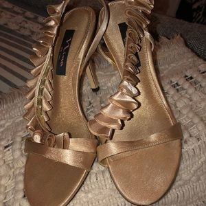 Champagne colored satin ruffled heels
